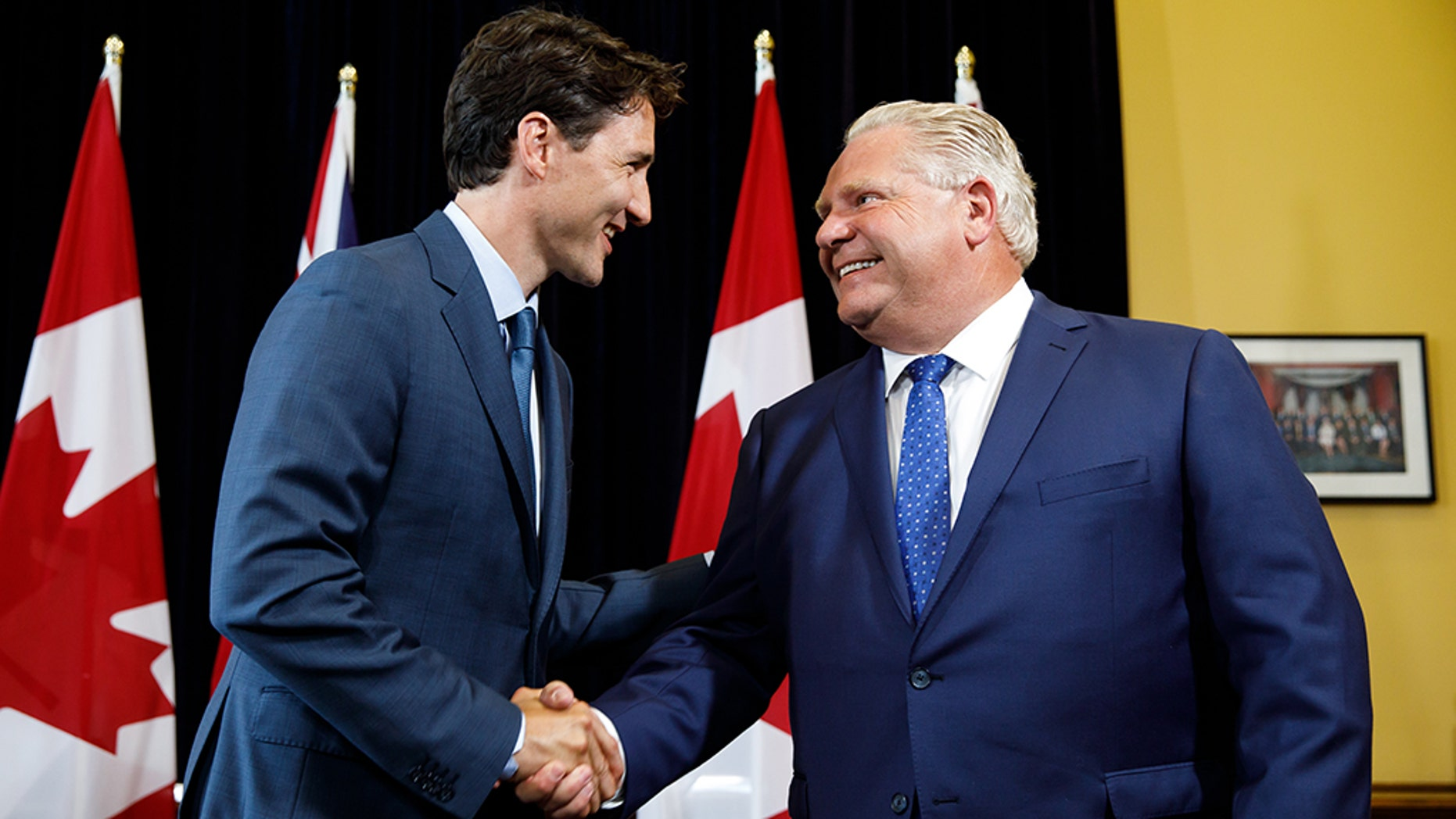 Civil for now: Prime Minister Trudeau meets with Premier Doug Ford in Toronto earlier this year; they have been at loggerheads over Trudeau's carbon tax