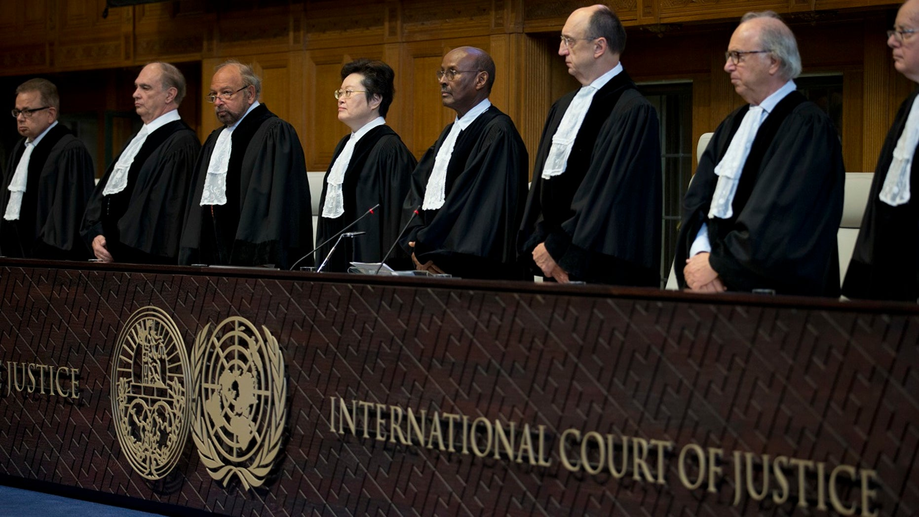 Judges enter the International Court of Justice, or World Court, in the Hague, Netherlands, where they ruled on an Iranian request to order Washington to suspend U.S. sanctions against Tehran, Oct. 3, 2018.