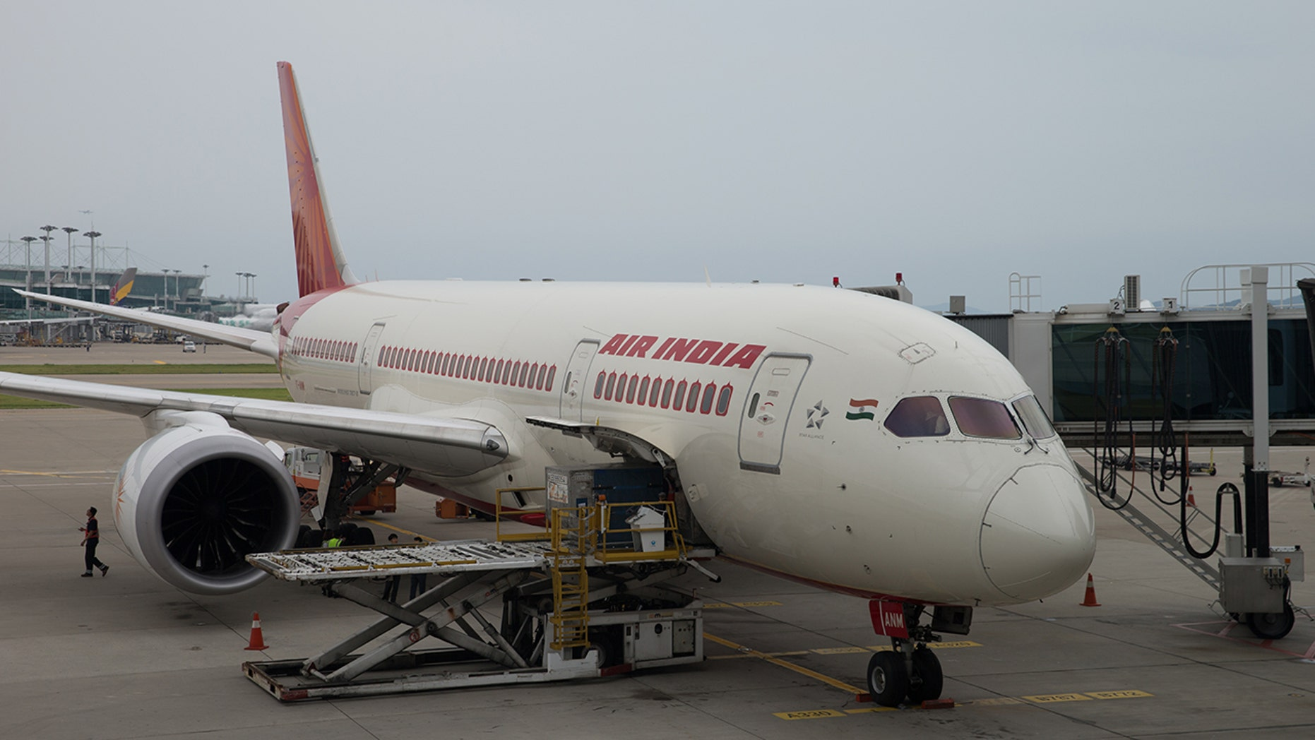 An Air India flight attendant sustained multiple injuries after falling out of an airplane as she prepared for boarding.