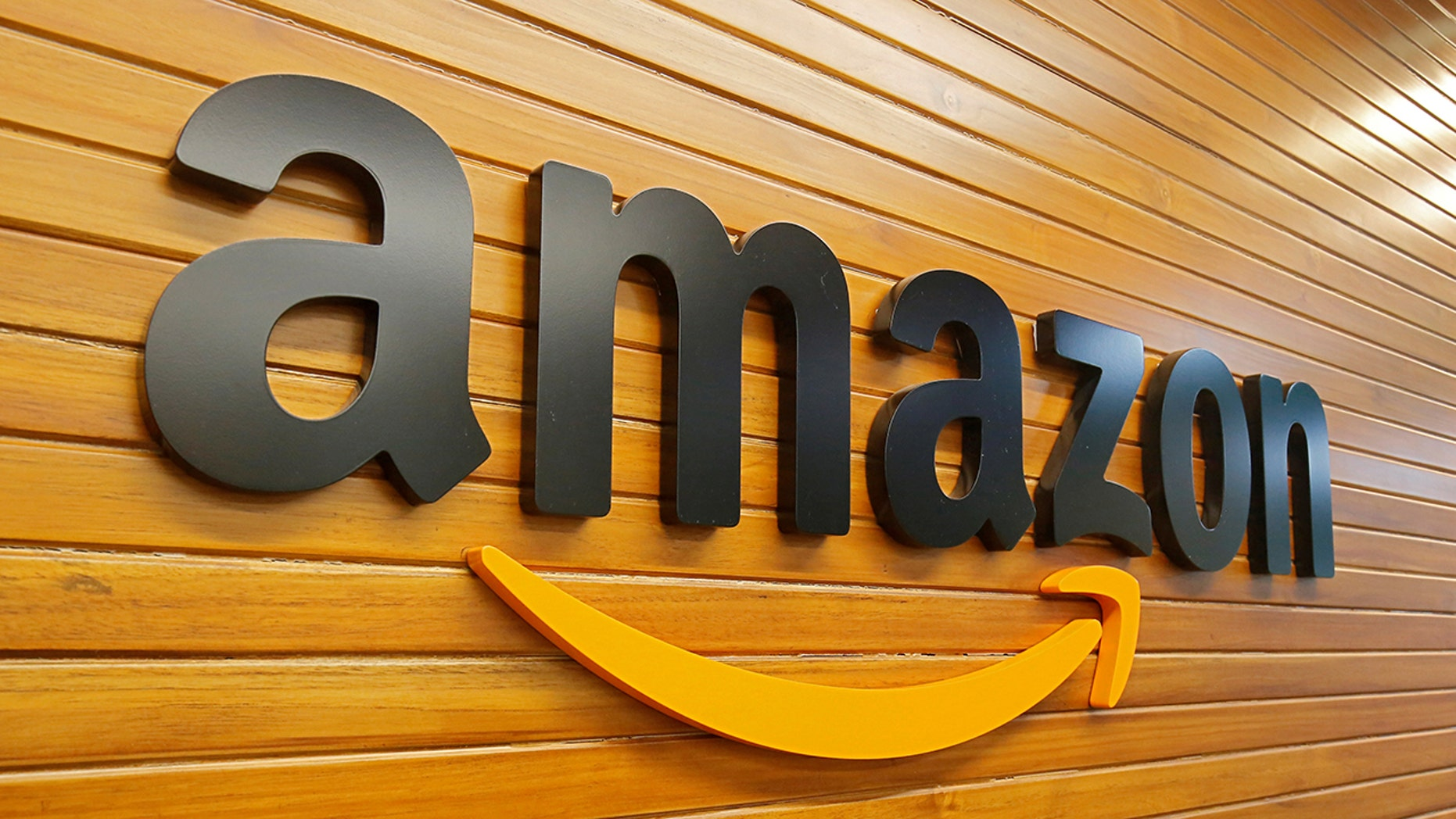 The trademark of Amazon is graphic above. (Reuters)