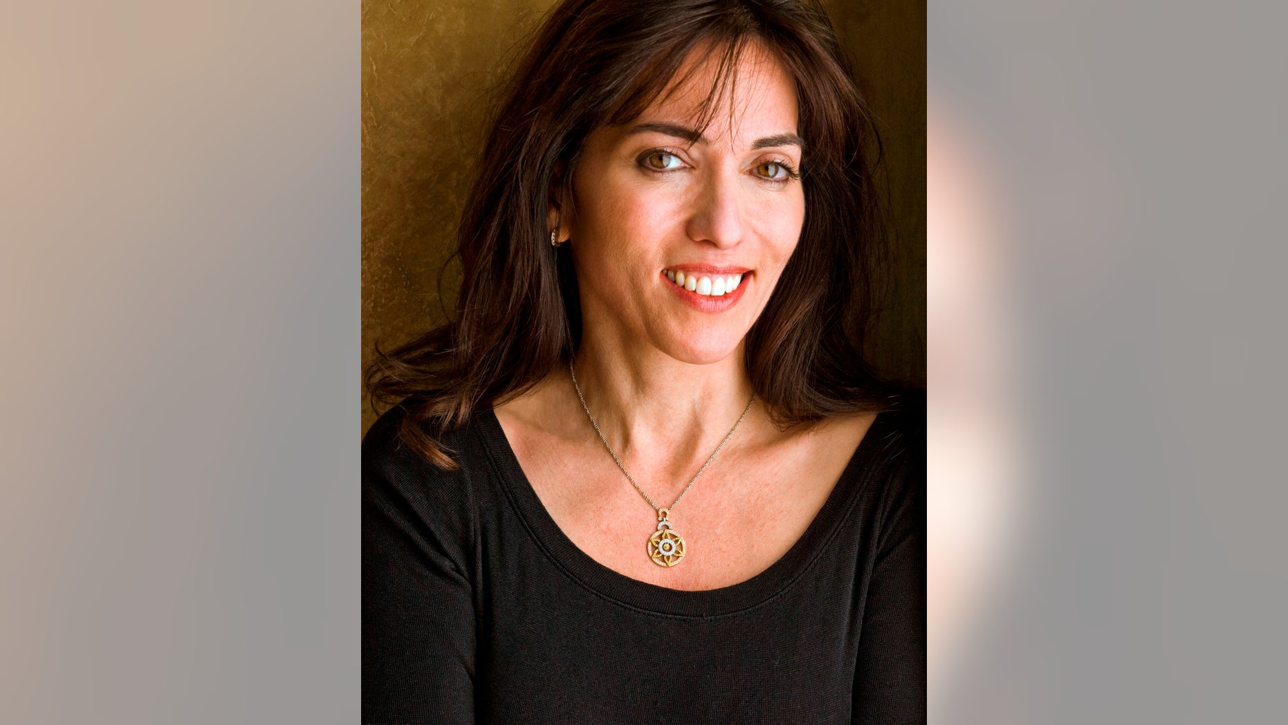 """This undated image released by United Talent Agency shows writer/director Audrey Wells. Wells, who wrote and directed the 2003 romantic comedy """"Under the Tuscan Sun,"""" has died after a five-year battle with cancer. A representative from United Talent Agency says Wells passed away Thursday, Oct. 4, 2018. She was 58."""