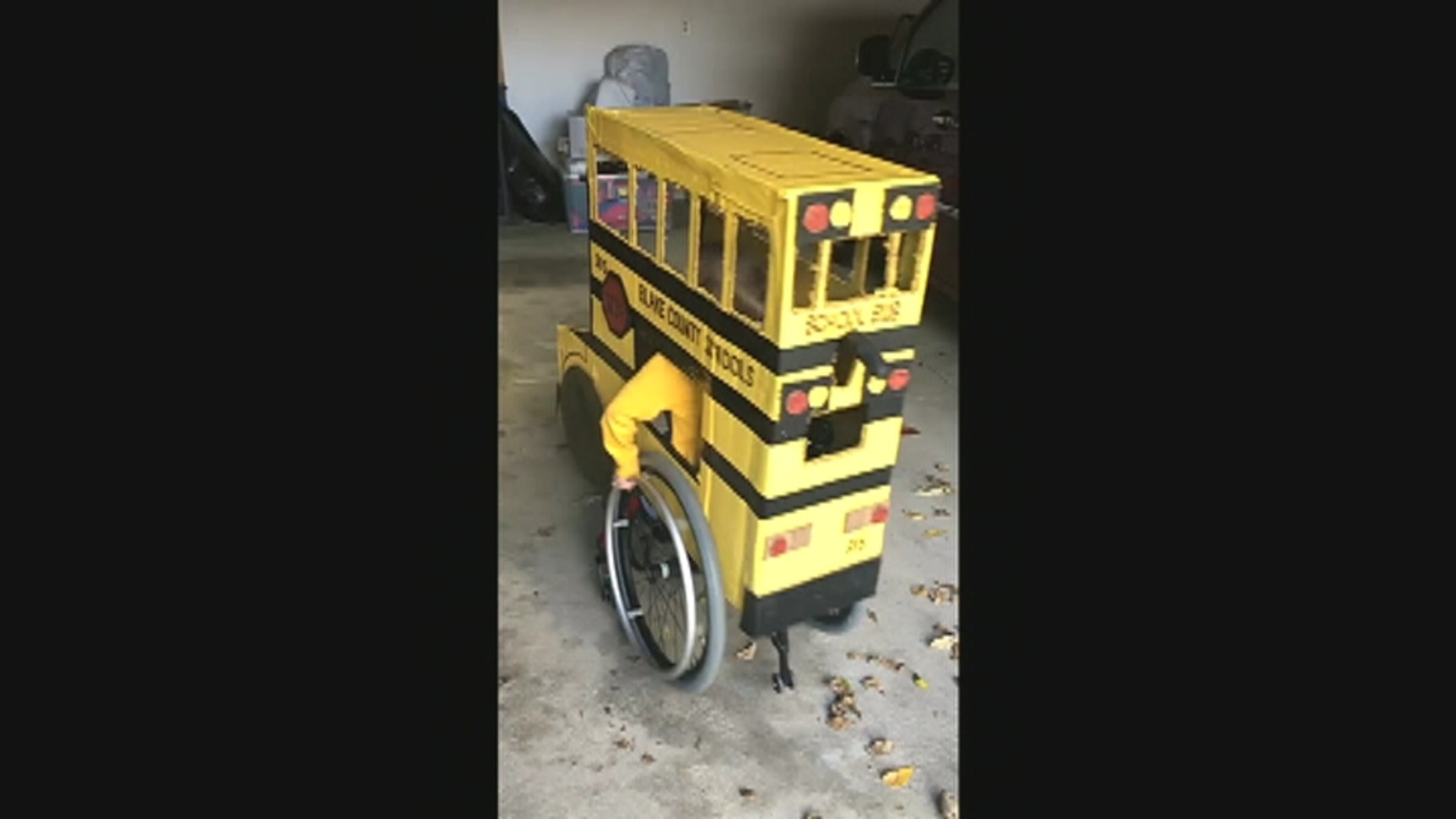 """Blake Mompher is pictured inside his """"Blake County Schools"""" bus costume."""