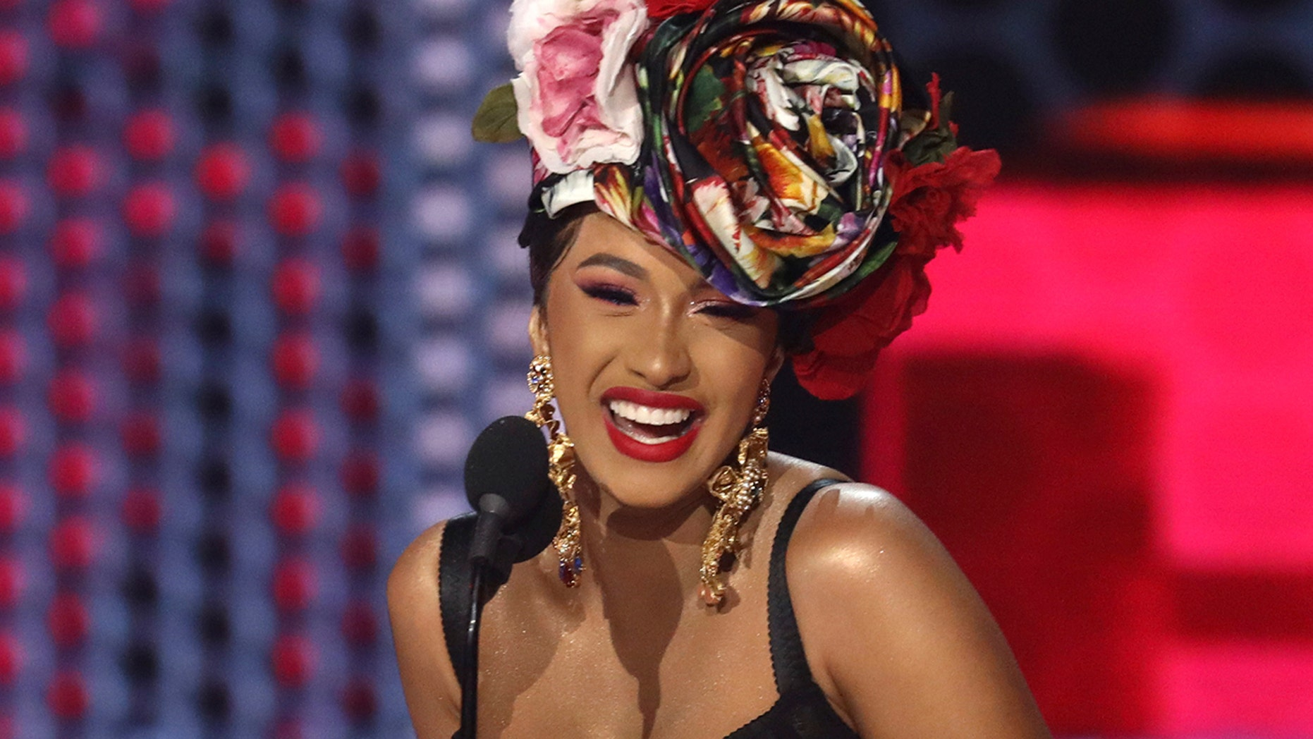 Cardi B accepts the award for accepted rap/hip-hop artist on the American Song Awards on Tuesday, Oct. 9, 2018, on the Microsoft Theater in Los Angeles.