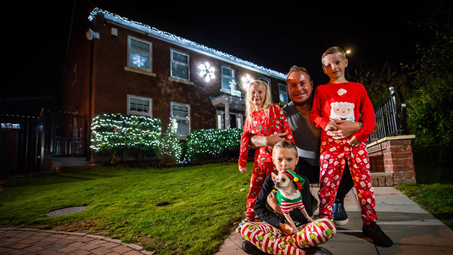 British family puts up Christmas decorations, multiple ...