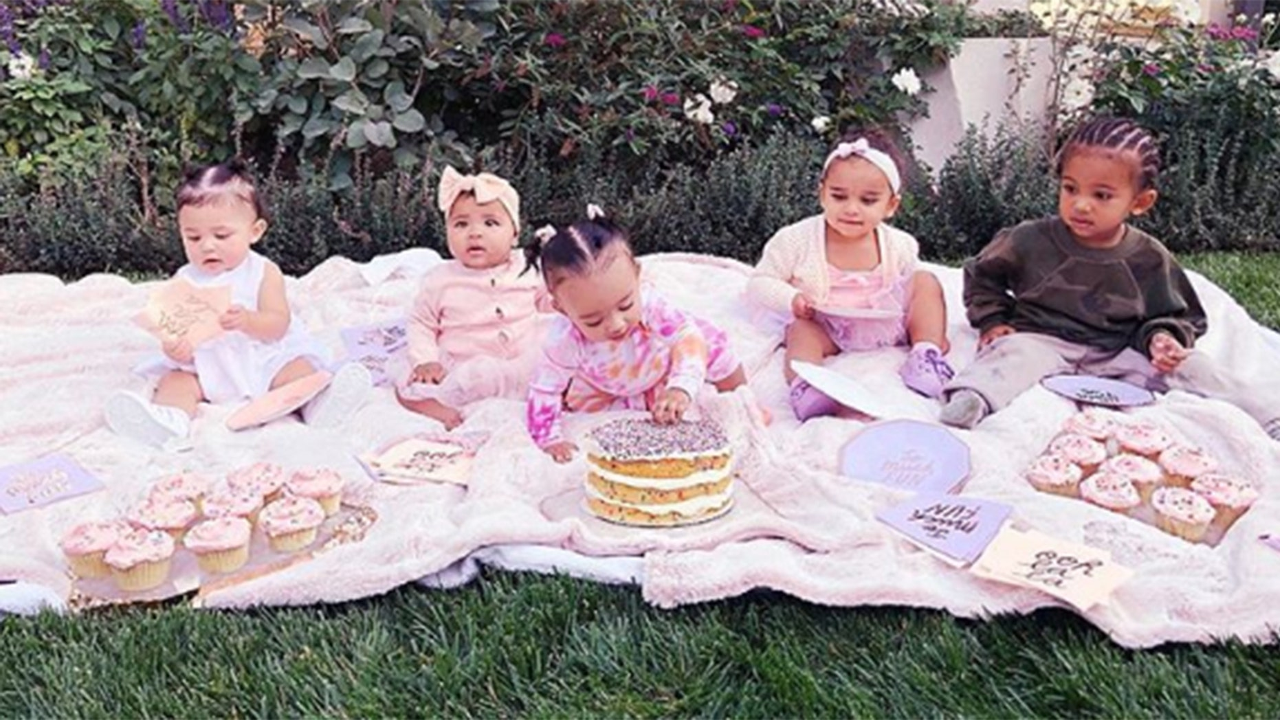 "Khloe Kardashian hosts her nieces and nephews for a ""cousin cupcake party"" to celebrate daughter True Thompson's 6-month birthday."