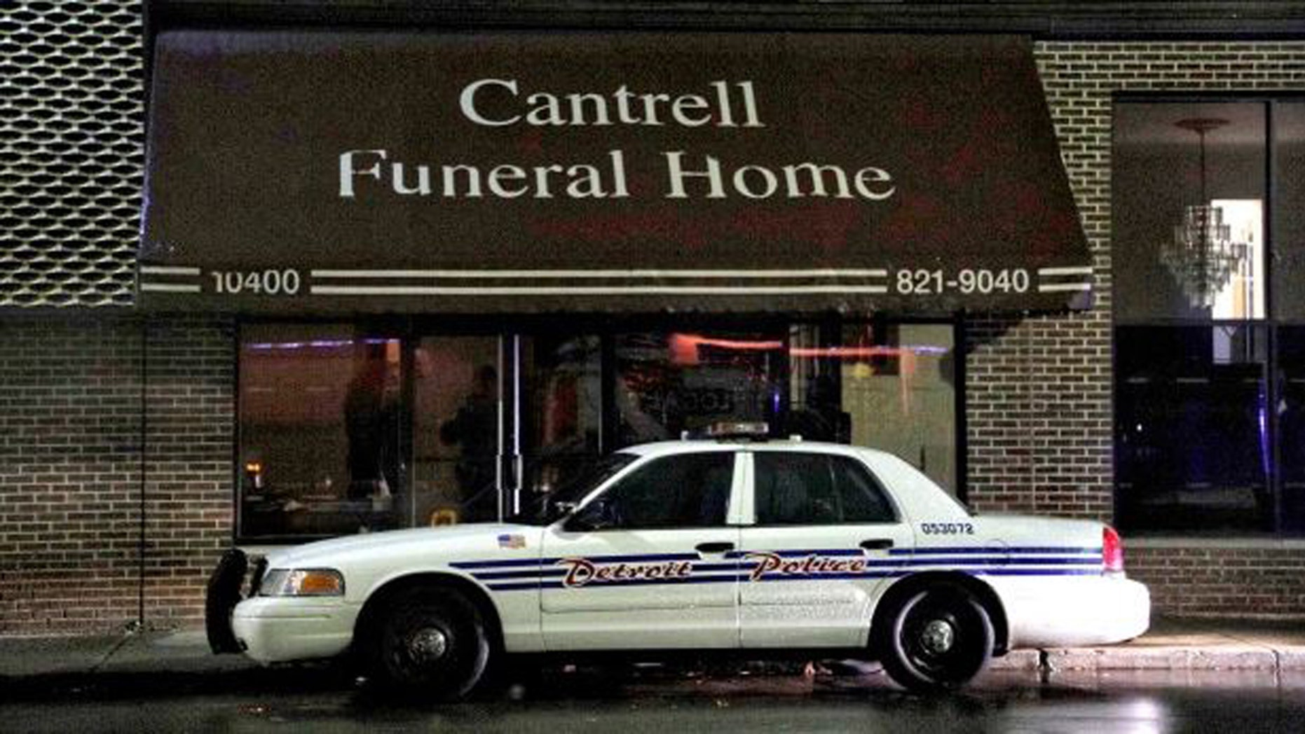 A Detroit Police vehicle is parked outside the Cantrell Funeral Home in Detroit on Friday, Oct. 12, 2018.