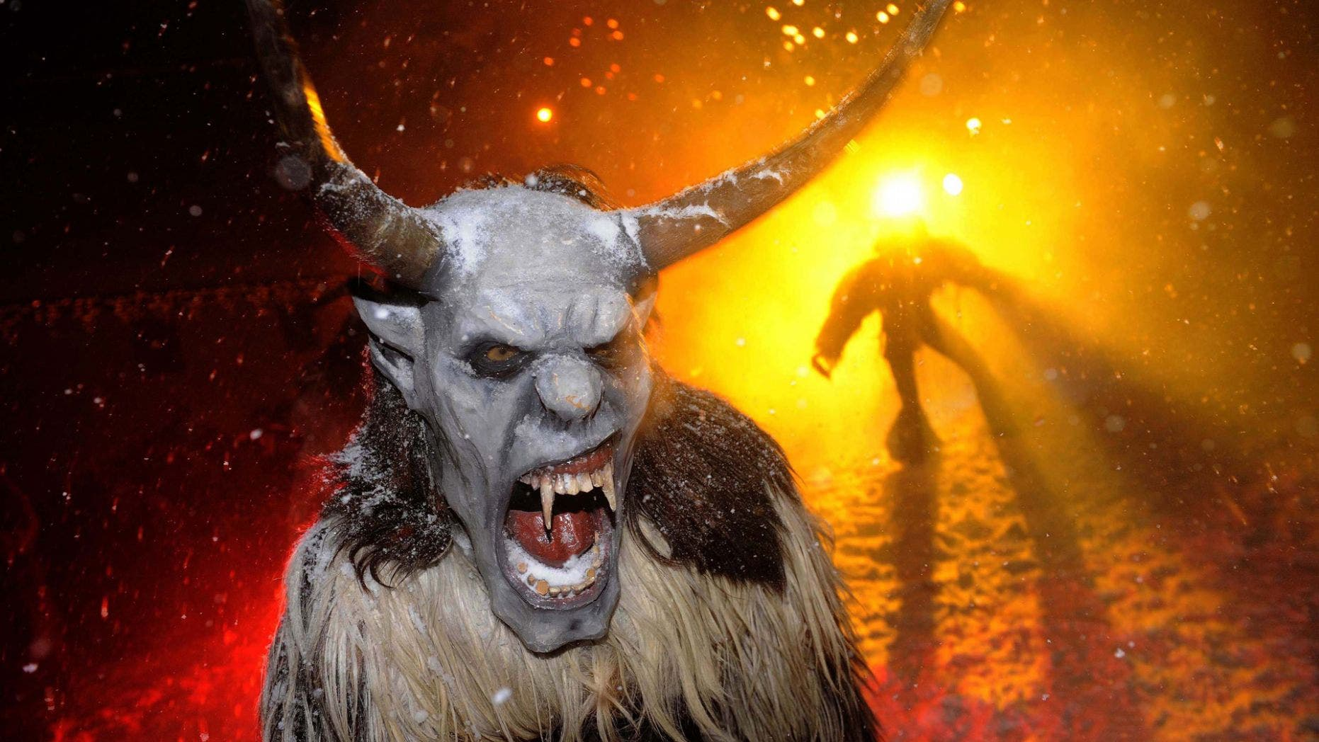 """File photo - Actors dressed as devils perform during the """"gathering of the devils"""" ahead of Saint Nicholas Day in Podkoren December 1, 2010. (REUTERS/Bor Slana)"""