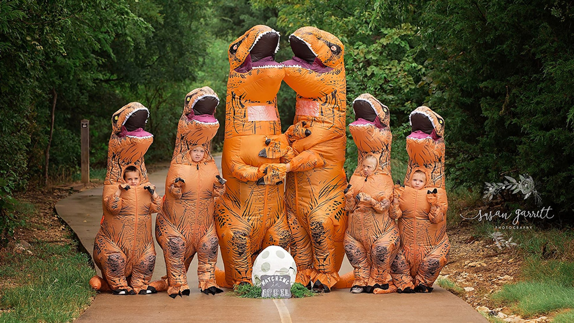 In the hilarious pregnancy announcement, Nicole and Daniel Berkley of Aubrey dressed up along with their kids - Myleigh, 10, Montana, 6, Lane, 5 and Hannah, 4 – in matching oversized, prehistoric reptile outfits for a memorable photoshoot.