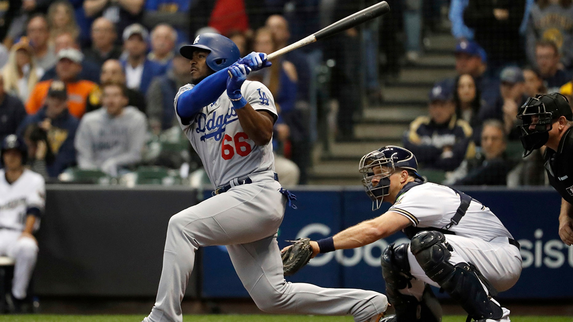 Los Angeles Dodgers' Yasiel Puig (66) hits a three-run home run during a sixth inning of Game 7 of a National League Championship Series round diversion opposite a Milwaukee Brewers Saturday, Oct. 20, 2018, in Milwaukee.