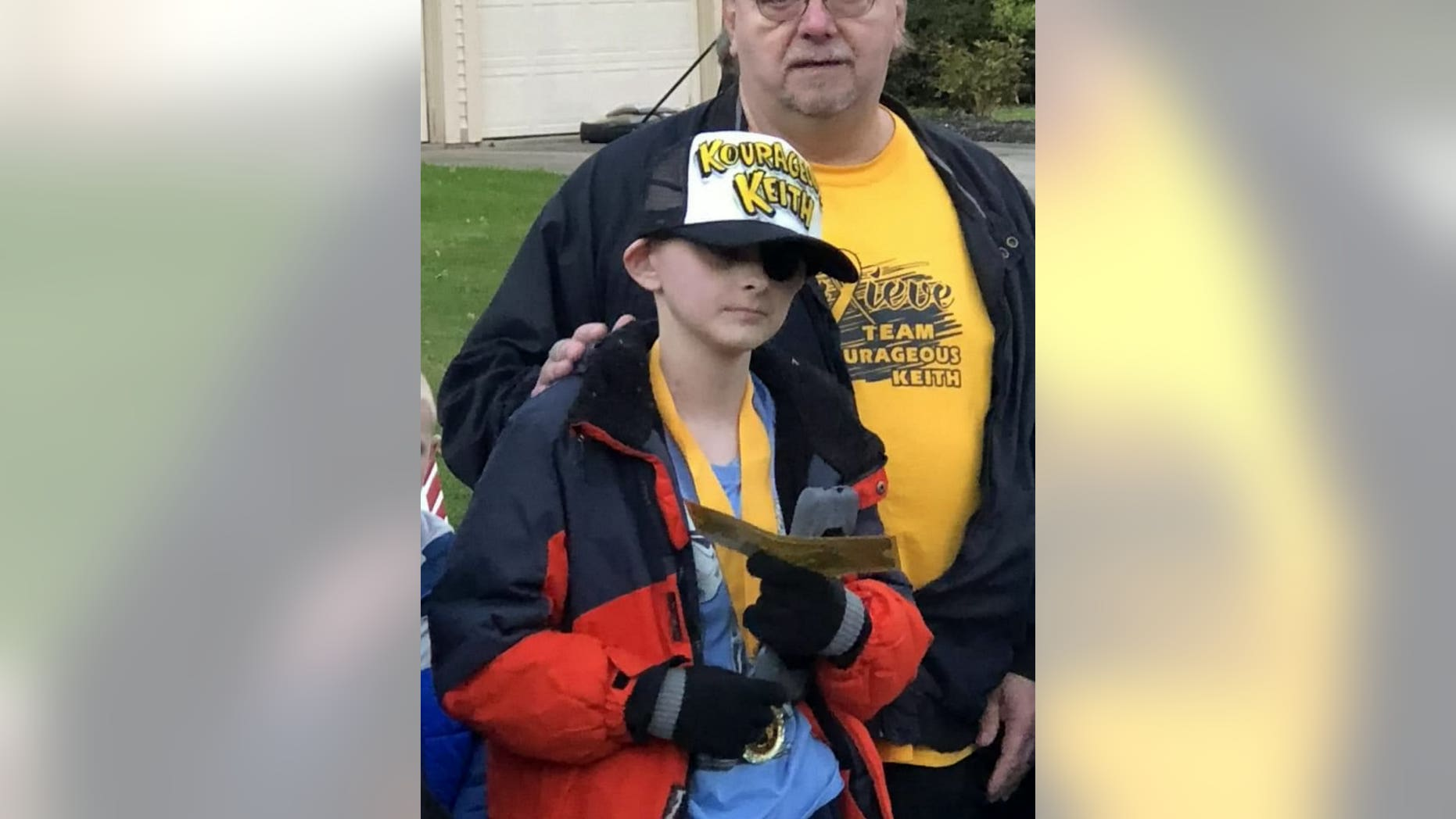 Keith Burkett, 12, holds his Golden Ticket for the Polar Express, which was part of his town's early Christmas celebration held in his honor.