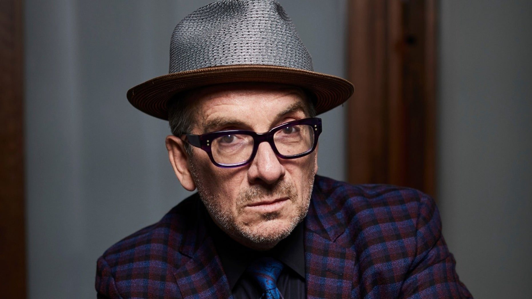 Elvis Costello slammed reports that stated he was struggling with cancer.