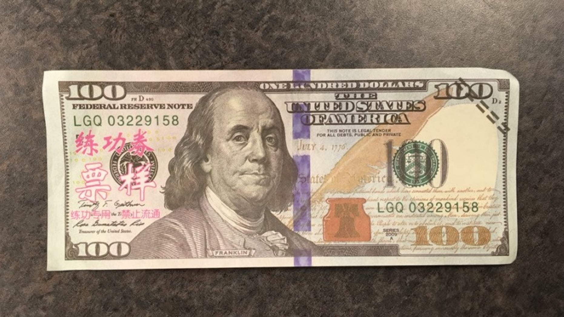 It's easy to spot how this $100 bill is fake.