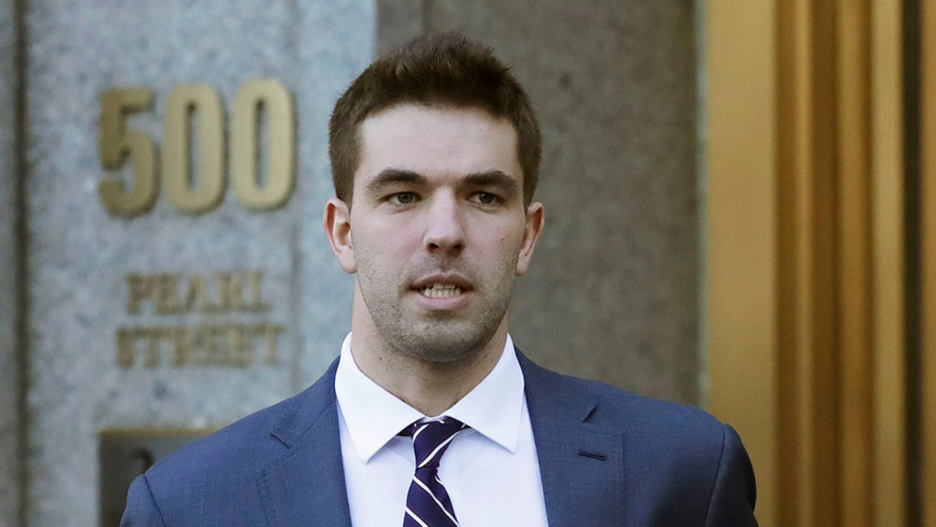 "FILE - In this March 6, 2018 file photo, Billy McFarland, the promoter of the failed Fyre Festival in the Bahamas, leaves federal court after pleading guilty to wire fraud charges in New York. A federal judge has given McFarland a six-year prison term. McFarland was sentenced Thursday, Oct. 11 in Manhattan federal court. Judge Naomi Reice Buchwald called him a ""serial fraudster."""