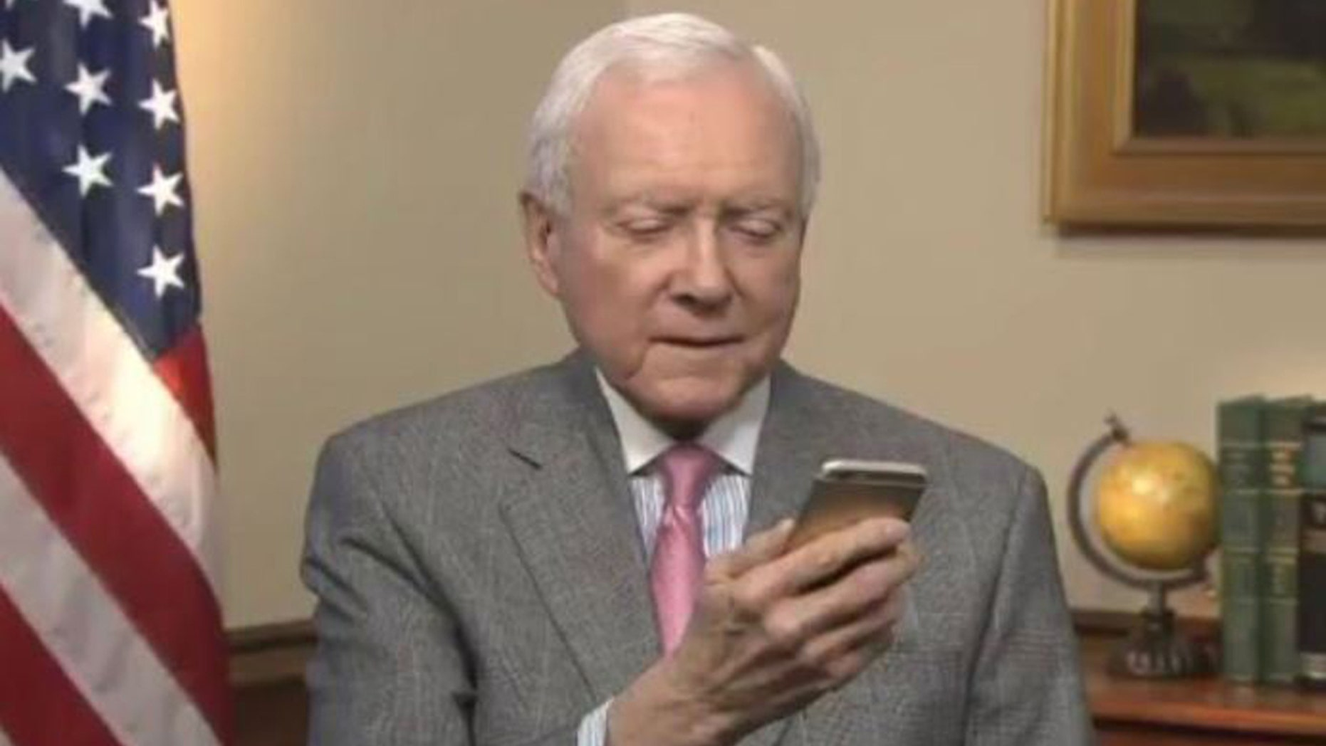 Sen. Orrin Hatch appears to look at his 1/1032 T-Rex DNA test results, in a picture he tweeted on Monday.