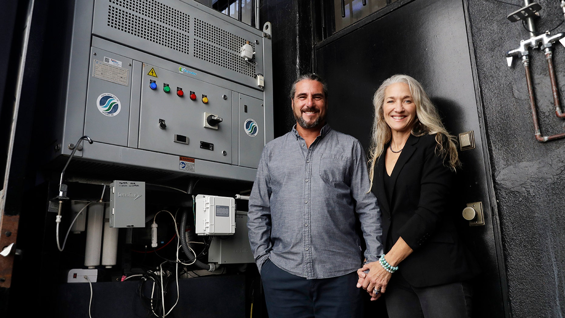 The Skysource/Skywater Alliance co-founders David Hertz, left, and his wife Laura Doss-Hertz pose for a portrait next to the Skywater 300 Wednesday in Los Angeles.