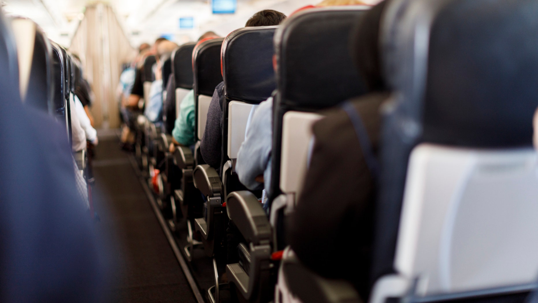 An airline passenger was reportedly spotted allowing her toddler to use a portable potty in the aisle of the plane.