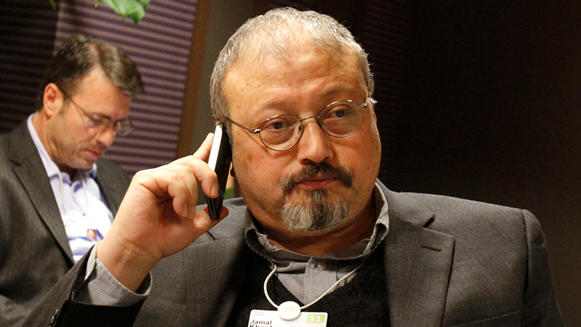Saudi Arabian journalist Jamal Khashoggi speaks on his cell phone at the World Economic Forum in Davos Switzerland in 2011