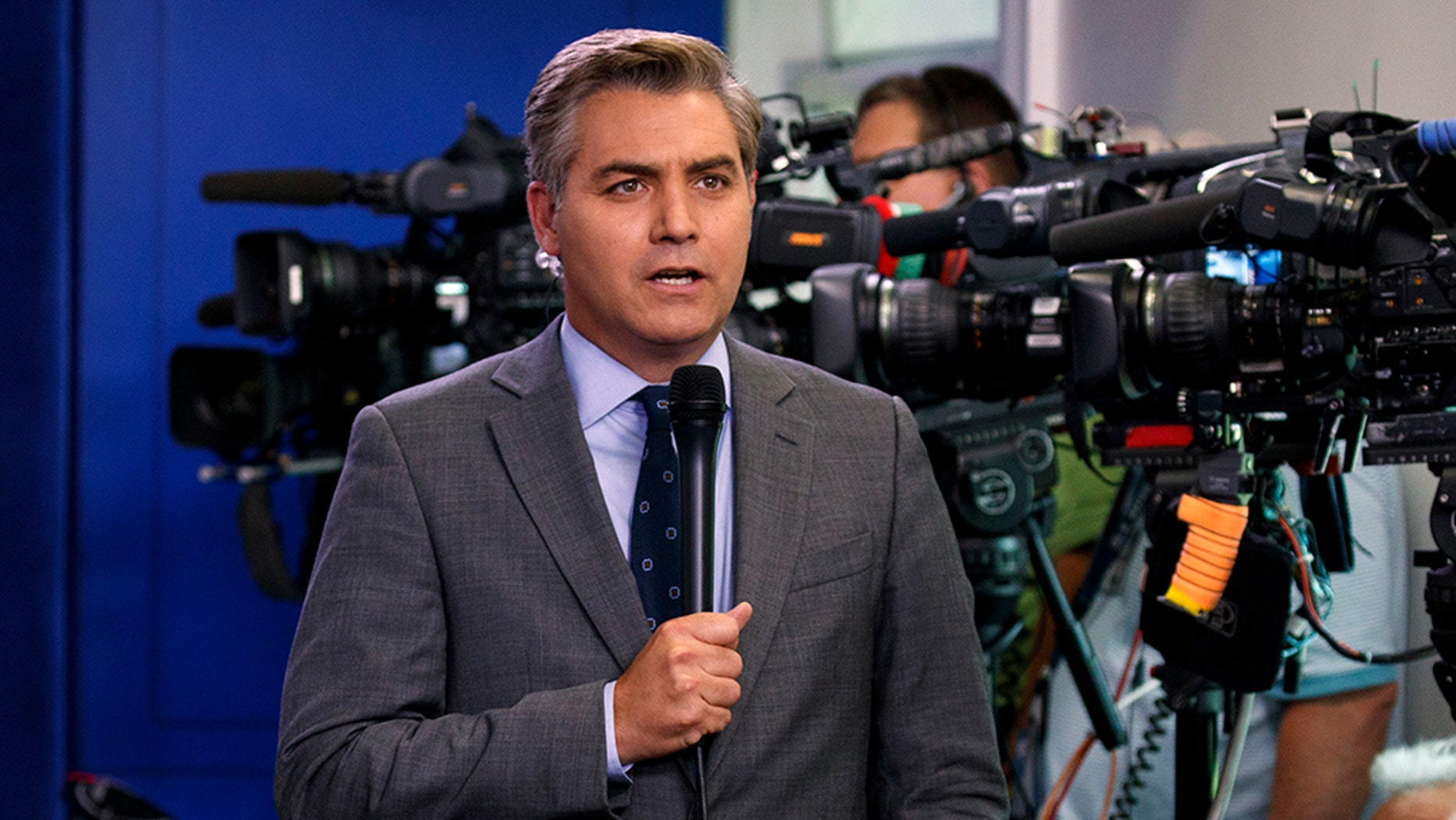"CNN's Jim Acosta warned viewers Friday that ""negative information"" about President Trump could appear in the Mueller report and that the president's administration ""may have to deal with the fallout."" (Associated Press)"