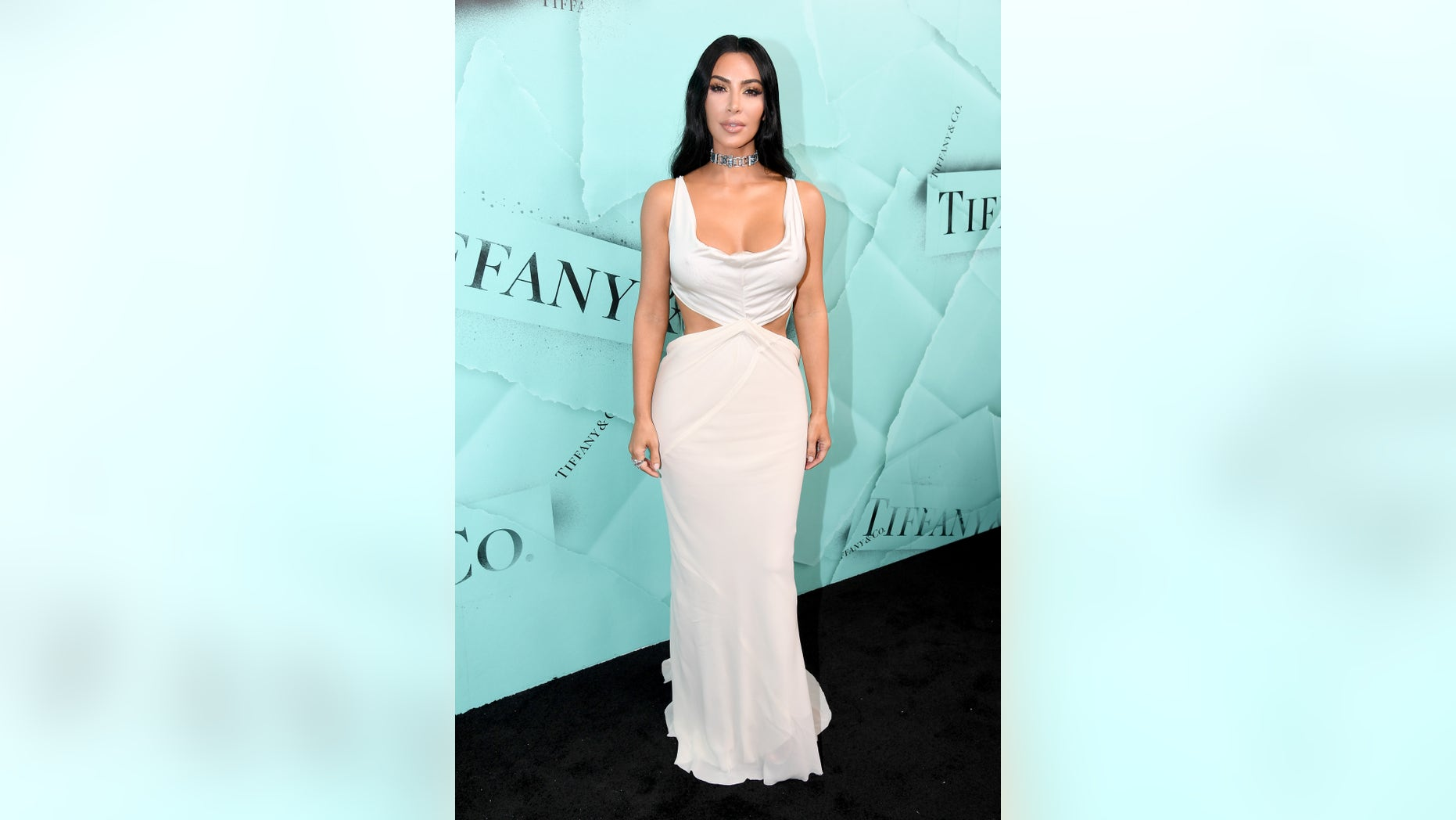 """Kim Kardashian West reveals that despite always posing without clothes, she is actually """"more conservative"""" in the bedroom."""