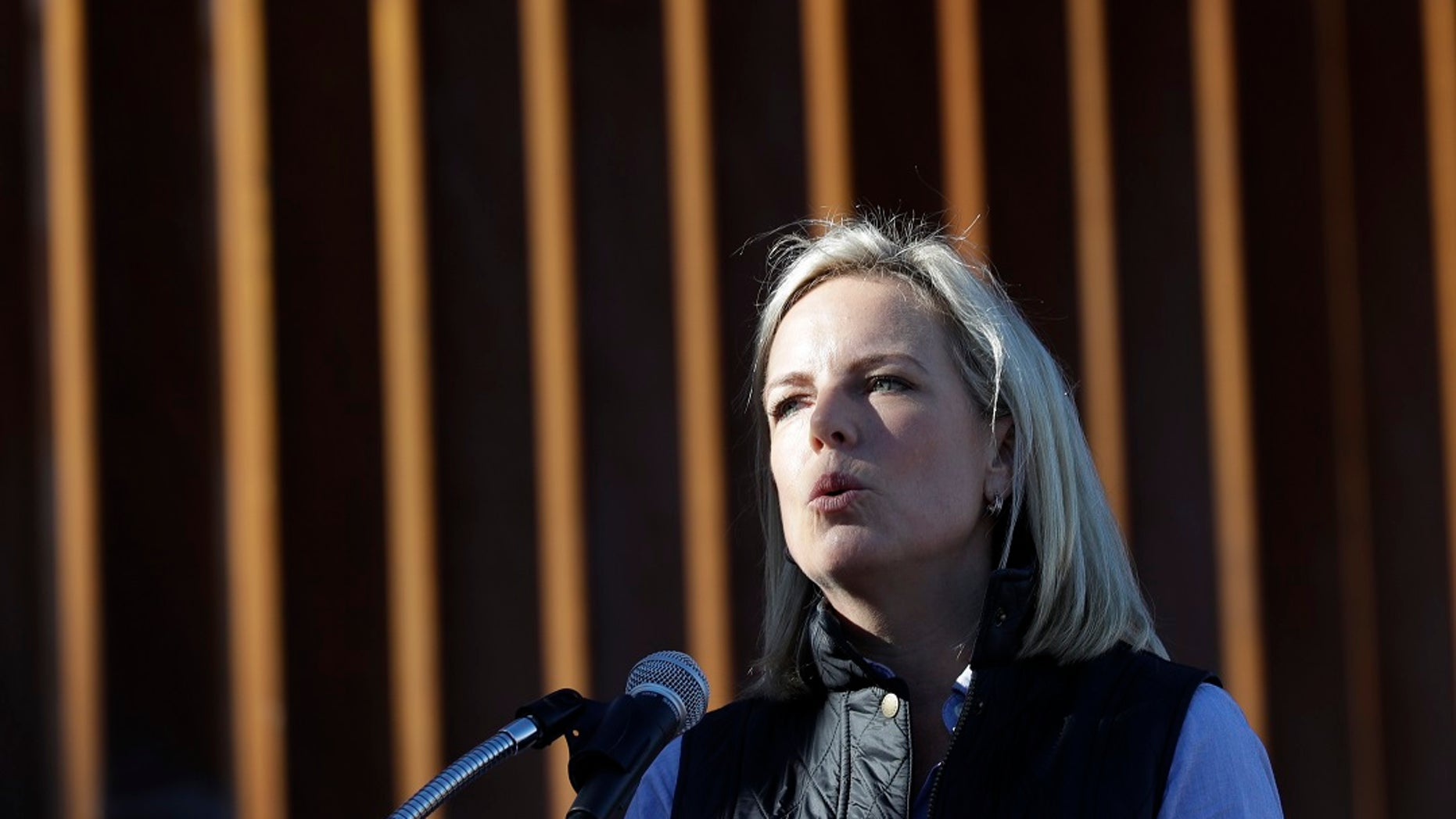U.S. Department of Homeland Security Secretary Kirstjen Nielsen speaks in front of a newly fortified border wall structure on Friday.