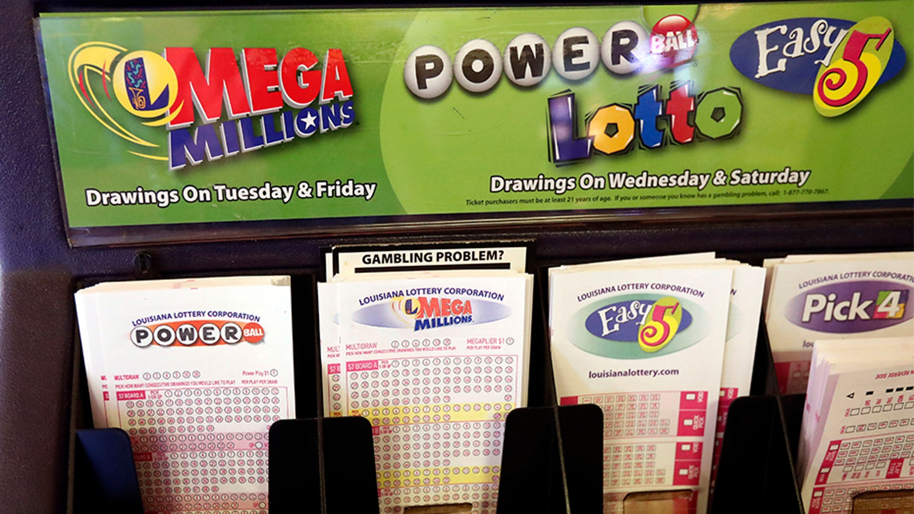 Lottery forms for Louisiana Mega Millions, Powerball and other lottery games fill the drawer at The World Bar and Grill, in Delta, La.