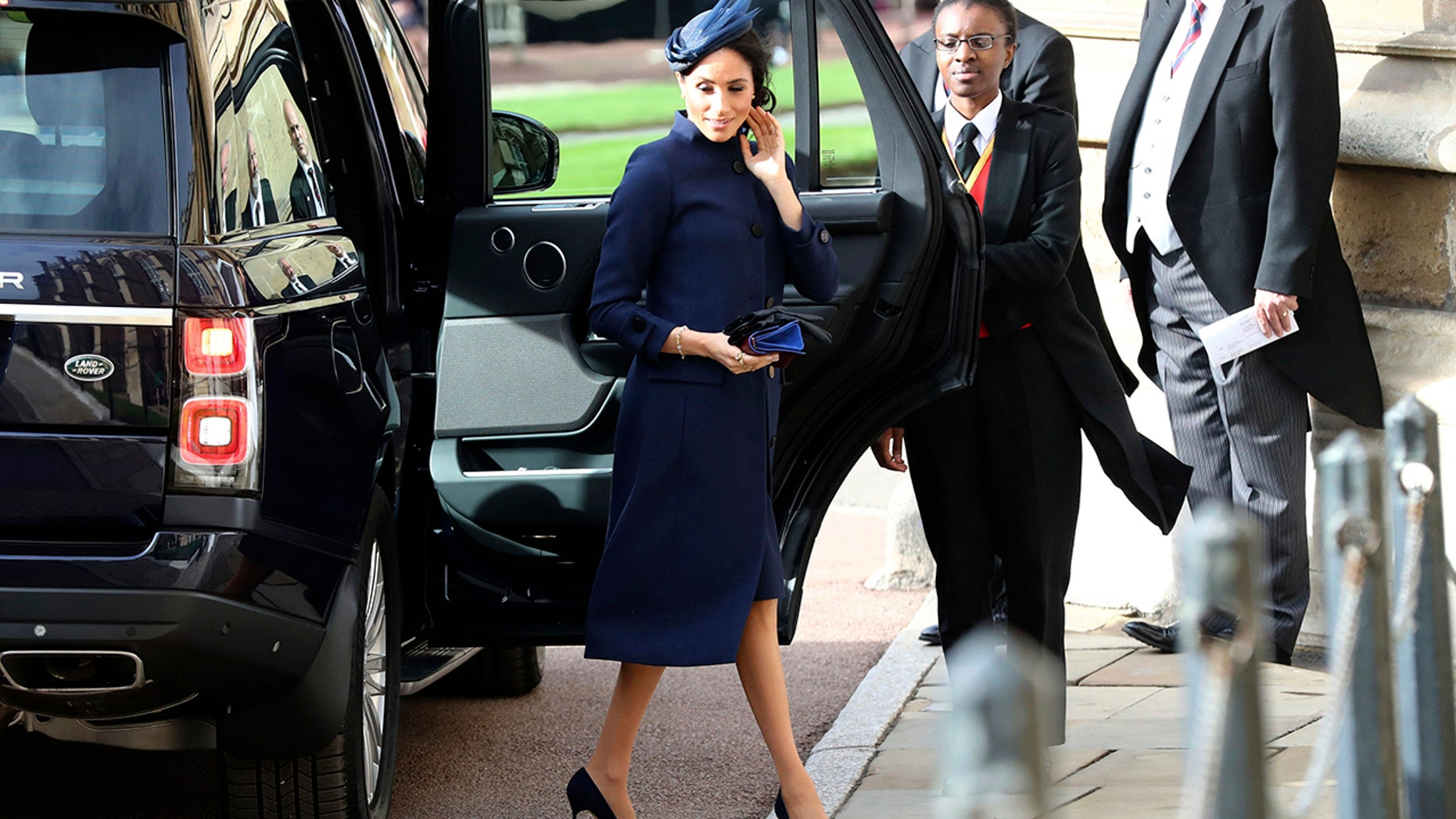 Meghan, Duchess of Sussex arrives ahead of the wedding of Princess Eugenie of York and Jack Brooksbank at St George's Chapel, Windsor Castle, near London, England, Friday Oct. 12, 2018. (Gareth Fuller/Pool via AP)