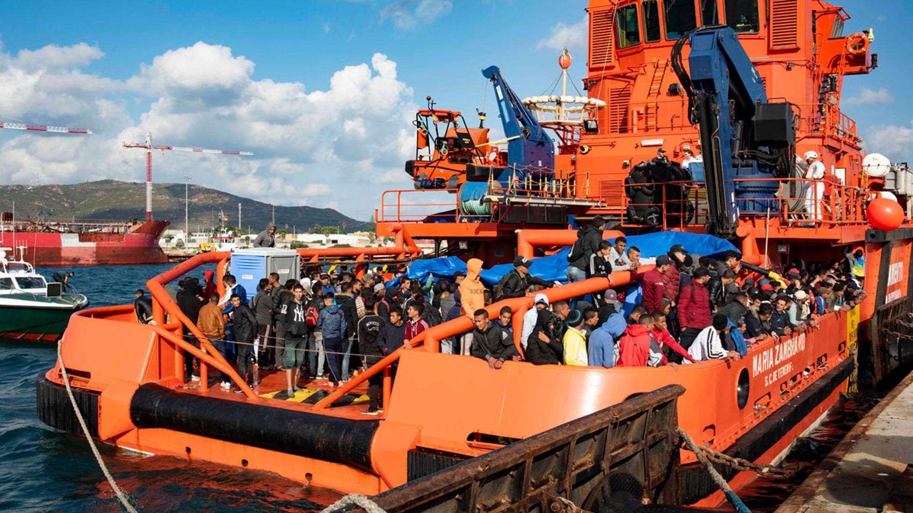 In this photo taken on Saturday, Oct. 27, 2018, migrants arrive at the port of San Roque, southern Spain, after being rescued by Spain's Maritime Rescue Service in the Strait of Gibraltar.