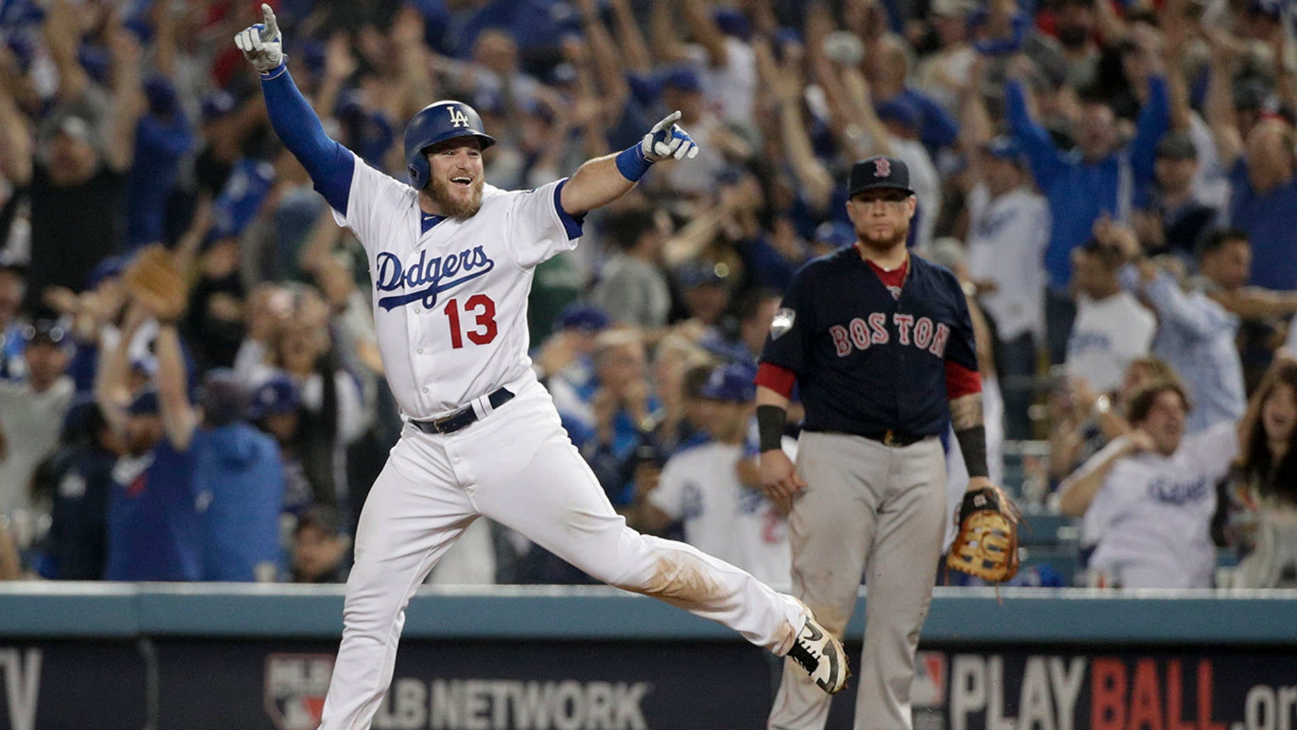 Los Angeles Dodgers' Max Muncy celebrates after his walk-off home run against the Boston Red Sox in the 18th inning of Game 3 of the World Series, on Saturday, Oct. 27, 2018, in Los Angeles. (Associated Press)  Dodgers top Red Sox, 3-2, in marathon 18-inning Game 3 of World Series muncy prancing clebrating game 3 ws win