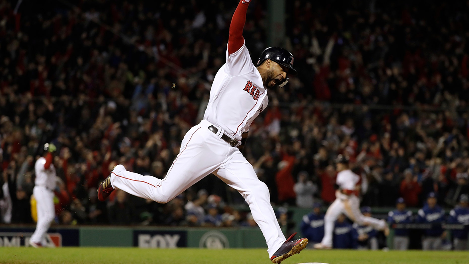 Boston Red Sox's Eduardo Nunez reacts as he runs the bases after hitting a three-run home run during the seventh inning of Game 1 of the World Series baseball game against the Los Angeles Dodgers on Tuesday.