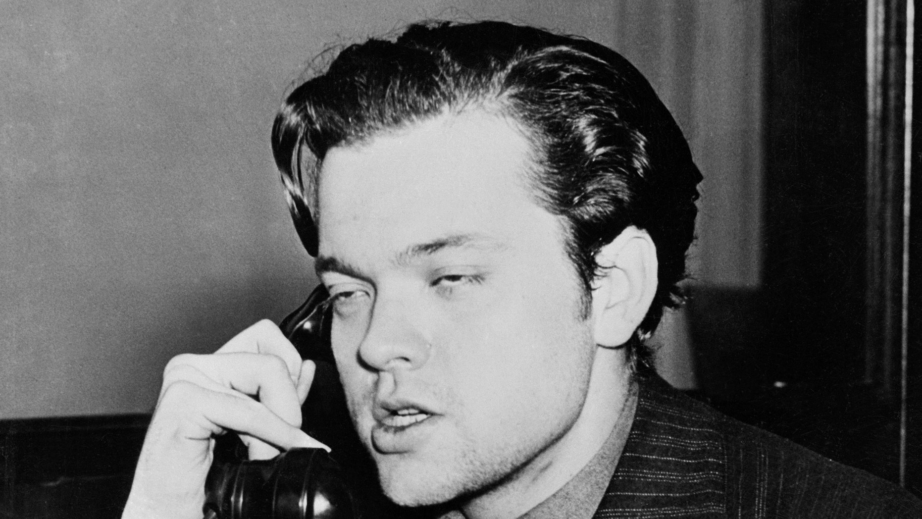 """(Original Caption) Orson Welles as he appeared after the radio broadcast War of the Worlds, a dramatic radio version of an imaginary landing of a """"Machine from Mars,"""" which causes panic among listeners throughout the United States, October 30. Orson Welles (shown above) adopted the original story by H.G. Wells for the Panic program and also played a principal role."""