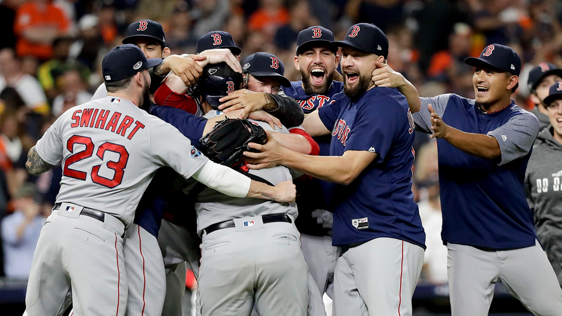 The Boston Red Sox celebrates after winning Game 5 of a baseball American League Championship Series against the Houston Astros on Thursday, Oct. 18, 2018, in Houston.