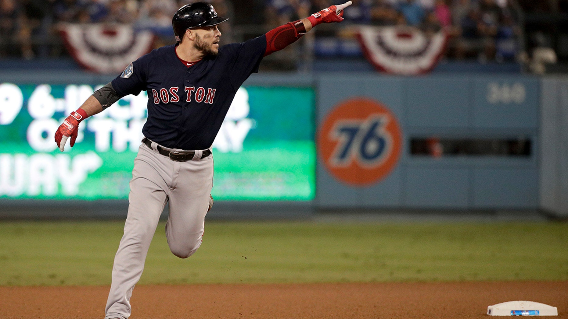 Boston Red Sox's Steve Pearce celebrates after his home run against the Los Angeles Dodgers during the eighth inning in Game 4 of the World Series baseball game on Saturday, Oct. 27, 2018, in Los Angeles. (Associated Press)