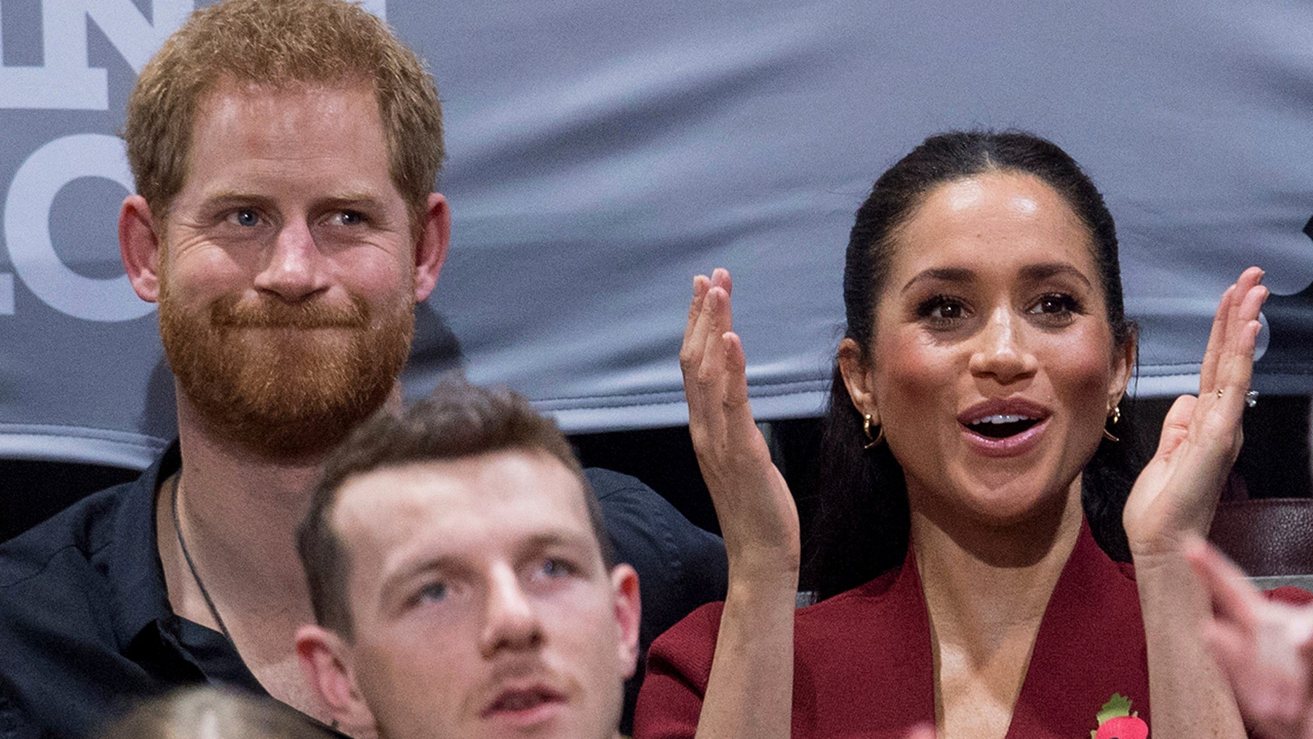 Britain's Prince Harry and Meghan, Duchess of Sussex applaud as they watch the wheelchair basketball final at The Invictus Games in Sydney, Australia, Saturday, Oct. 27, 2018. Prince Harry and his wife Meghan are on day twelve of their 16-day tour of Australia and the South Pacific. (AP Photo)
