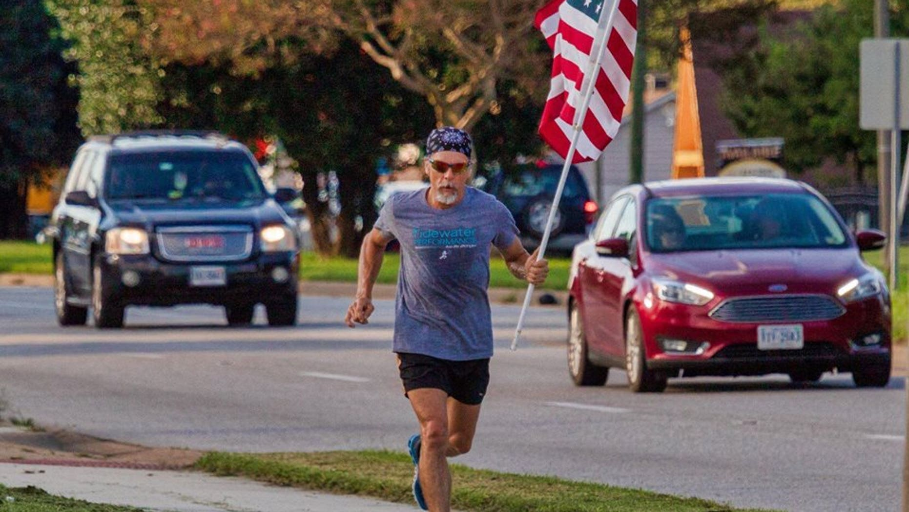 Virginia man Wayne Parfitt runs with the flag in hand to honor his son, who is deployed overseas.