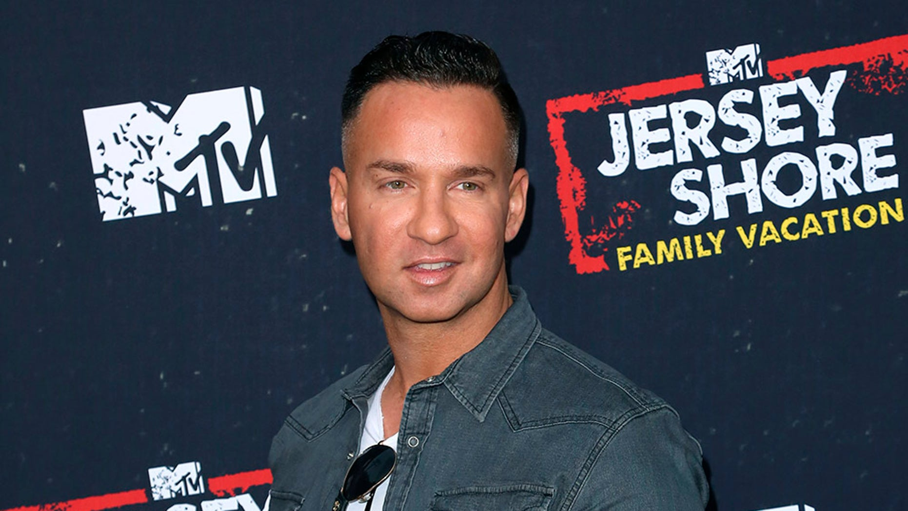 "FILE - In this March 29, 2018 file photo, Mike ""The Situation"" Sorrentino arrives at the ""Jersey Shore Family Vacation"" premiere in Los Angeles. Sorrentino is seeking probation when he's sentenced Friday on tax charges, while prosecutors want a sentence of 14 months. Sorrentino pleaded guilty in January to concealing his income in 2011 by making cash deposits that wouldn't trigger federal reporting requirements. He and his brother were charged in 2014 with multiple tax offenses related to nearly $9 million in income. (Photo by Willy Sanjuan/Invision/AP, File)"