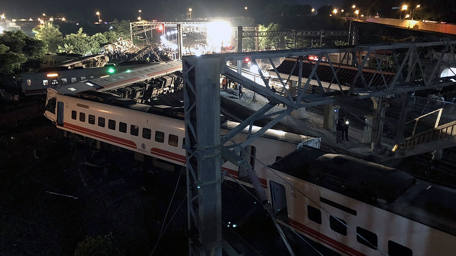 This photo released by Military News Agency shows a general view at the site of a train derailment in Lian in northern Taiwan on Sunday, Oct. 21 2018. The Puyuma express train was carrying more than 300 passengers toward Taitung, a city on Taiwan's southeast coast, when it went off the tracks on Sunday afternoon.