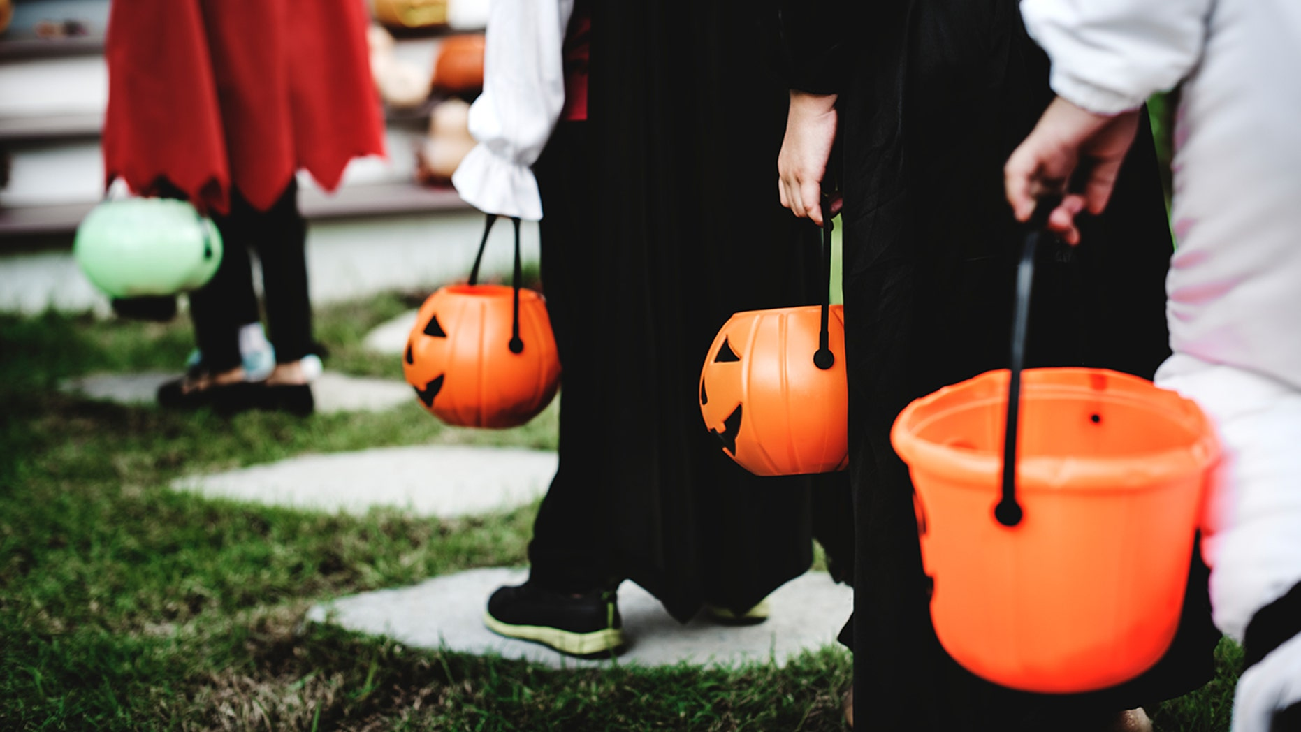 A mom who's too scared to go out on Halloween is hiring someone to take her kids trick-or-treating.