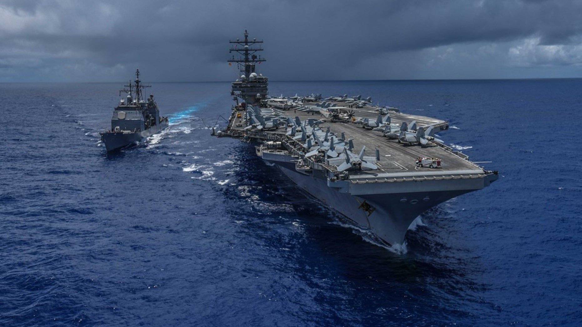 A U.S. Navy helicopter crashed on the flight deck of the USS Ronald Reagan in the Philippine Sea early Friday, injuring several sailors.