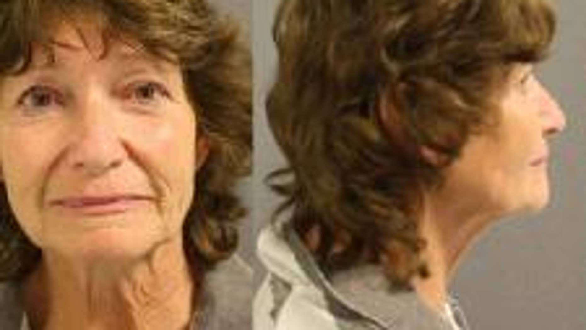 Linda Dwire, 64, was arrested on a harassment charge on Monday. She was captured on video in a verbal confrontation with another shopper defending two Spanish-speaking women.