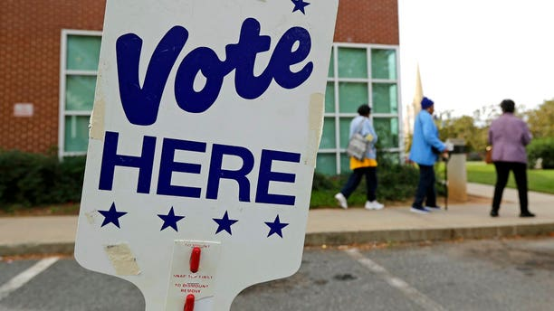 People arrive for early voting at a polling place in Charlotte, N.C., Tuesday, Oct. 23, 2018. (AP Photo/Chuck Burton)