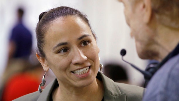 Democratic congressional candidate Sharice Davids couldbecome the first lesbian Native American woman ever elected to Congress.