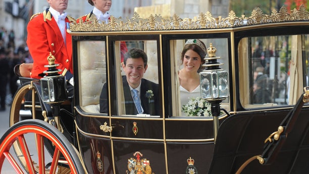 Princess Eugenie of York, right, and Jack Brooksbank travel from St George's Chapel to Windsor Castle after their wedding at St George's Chapel, Windsor Castle.