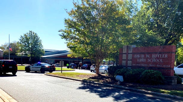Emergency personnel respond to a shooting at Butler High School in Matthews, N.C., on Monday, Oct. 29, 2018.