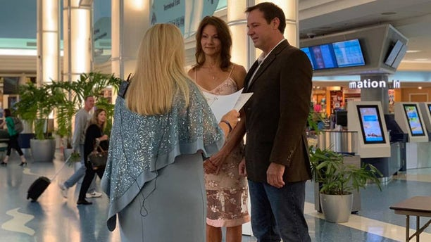 """On Oct. 10, Lorri and Jim Beary said """"I do"""" inside the air hub – which, they admit, was not initially their dream venue."""