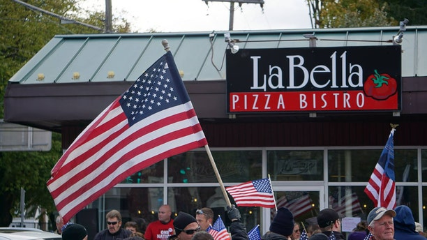 The front of La Bella Pizza Bistro in New Paltz, NY where hundreds in the community showed support for the proposed American flag mural.