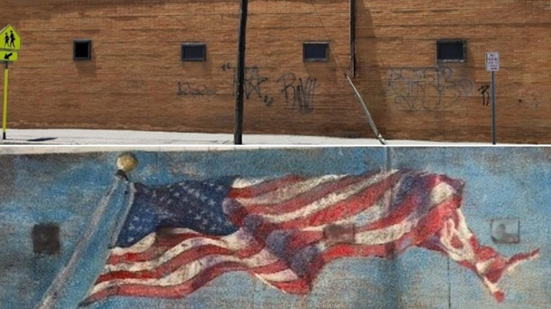 The current brick wall and the proposed American flag mural proposed for La Bella Pizza Bistro in New Paltz, NY.