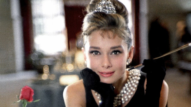 """Audrey Hepburn poses for a publicity still for the Paramount Pictures film """"Breakfast at Tiffany's"""" in 1961 in New York City, New York."""