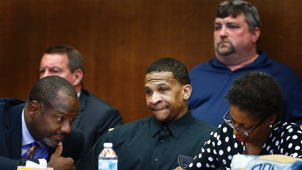 Defendant Quinton Tellis, center, looks on as the jury goes to deliberate his case in Batesville, Mississippi on Sept. 30, 2018.