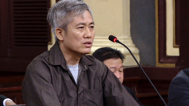 Luu Van Vinh stands trial in Ho Chi Minh City, Vietnam, Friday, Oct. 5, 2018. Vinh and four others were sentenced between eight to 15 years in prison for attempting to overthrow the government. (Thanh Chung/Vietnam News Agency via AP)