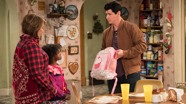 """Michael Fishman and Roseanne Barr pictured here on the seventh episode of the revival of """"Roseanne"""" on May 8, 2018."""